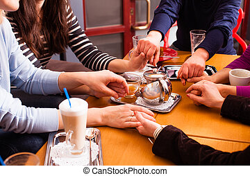 Family holding hands at the table