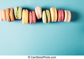 Pop art still life with colorfull macaroons on blue...