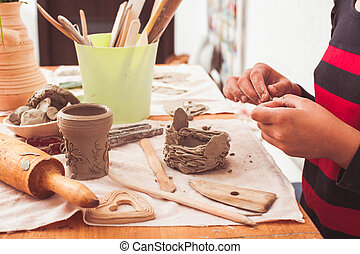 Child hands with plasticine - Process modeling figures from...