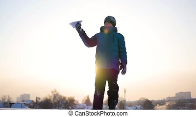 Children start a paper airplane in the sky. Winter frosty day