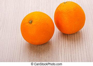 navel orange - valencia orange or navel orange on wood...