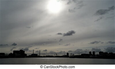 City clouds ship river sky sun bridge - The sky floating...