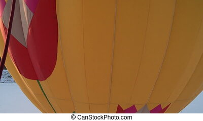 Huge bright balloon starting flight aerial view - Yellow and...