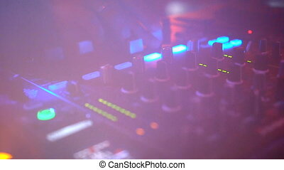 Closeup DJ equipment deck at the party - DJ hands on...