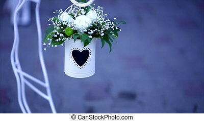 Wedding decoration - white metal bucket with white flowers on the blue background