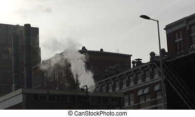 Pipe factory smoke industrial - Pipes throwing smoke in the...