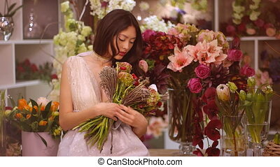 Woman and flowers. Asian girl with bouquet - Woman and...