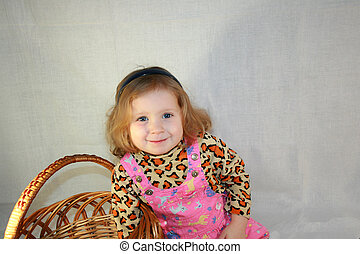 blond little girl with a basket of laughs