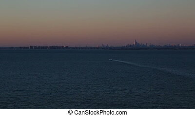 three shots of New York from the open sea