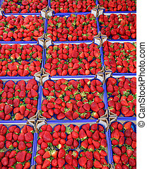red ripe strawberries in the box in the grocery sales -...