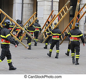many firefighters during exercise in the town square - many...