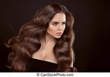Healthy hair. Wavy hairstyle. Beautiful brunette woman with...