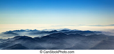aerial of mountain ridge od Los Angeles valley with fog
