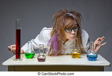 Sniffing shaggy scientist in lab on gray background
