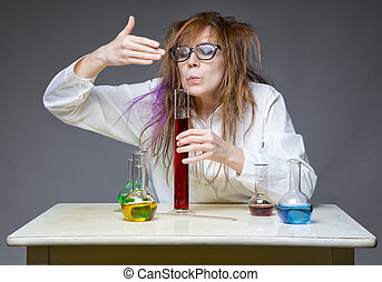 Sniffing messy scientist in lab on gray background