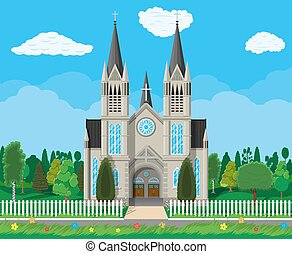 Catholic church cathedral with trees and fence - Exterior of...