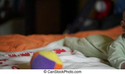 Baby boy playing, camera panning