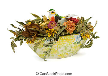 Dried flowers and bird in vase, isolated on white background