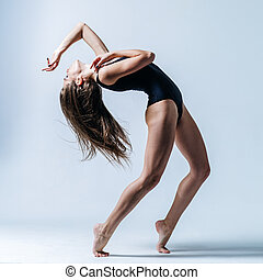 Young beautiful dancer posing in studio - Young beautiful...