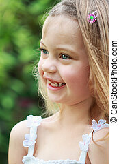 Laughing Child - Portrait of a laughing little girl in the...