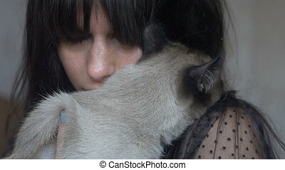 Brunette female with a cat