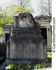 Carved Tombstone at Pere Lachaise Cemetery in Paris France