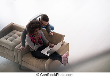 multiethnic couple shopping online - Happy young multiethnic...