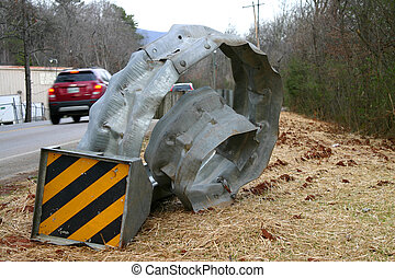 Mangled Guardrail 3 - cars drive past a curled and mangled...