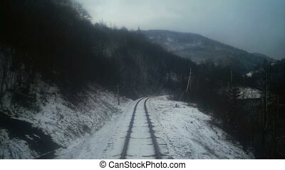 Train move winter forest mountain - Point of view train pass...