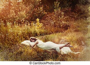 Levitation girl on the pillow. Sweet dream girls dream of...