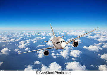 Passenger airplane flying above clouds, travel and vacation...