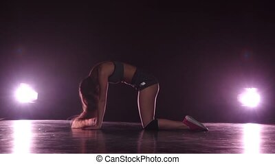Girl dancing in short shorts. Studio - Girl dancing in short...