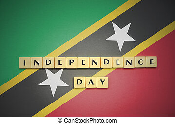 letters with text independence day on the national flag of saint kitts and nevis.
