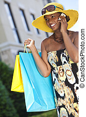 African American Woman With Cell Phone & Fashion Shopping Bags