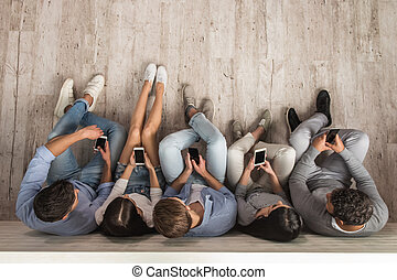 Young people with gadgets - Top view of beautiful young...