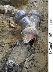 Sewer Line Problem Exposed - Closeup of broken old...
