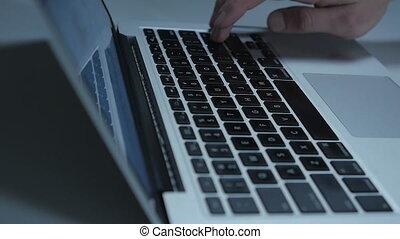 Close up man press enter on laptop keyboard