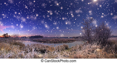 Christmas night with snowfall. Night xmas background. White...