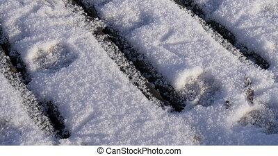 Camera slowly tilts snow pier