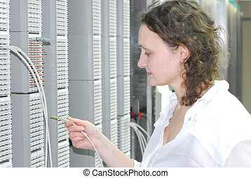 Communication engineer - Woman working on technical site of...