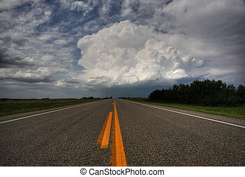 Storm clouds down a Saskatchewan highway