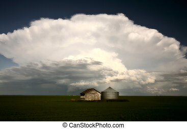 Storm clouds over Saskatchewan granaries