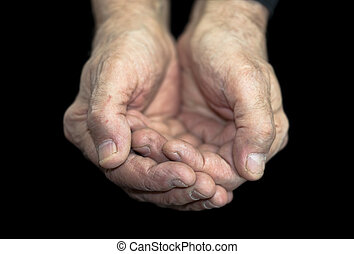 Poverty Old hands on black with clipping path