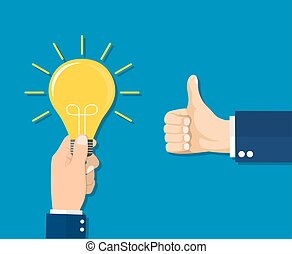 Good idea concept. Hand holding a lightbulb and an another...