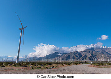 Many wind machines in the desert with cloudy skys
