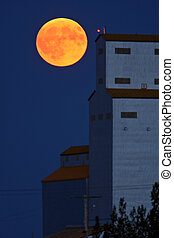 Full moon behind Tuxford grain elevator