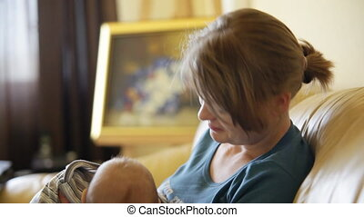 Baby boy and mother in living room