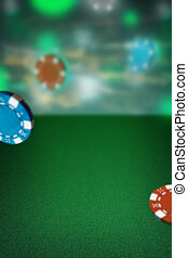 The chips for gamblings on green table. Poker concept