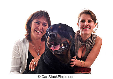 women and dog - two smiling women and a purebred rottweiler...
