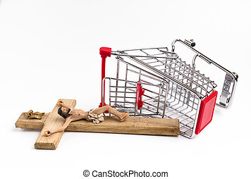 Shopping cart overturned with crucifix on the ground....